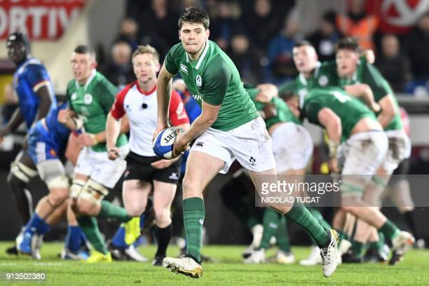 Ireland's flyhalf Harry Byrne runs with the ball during the Six Nations U20 rugby match France versus Ireland on February 2 2018 at the ChabanDelmas...