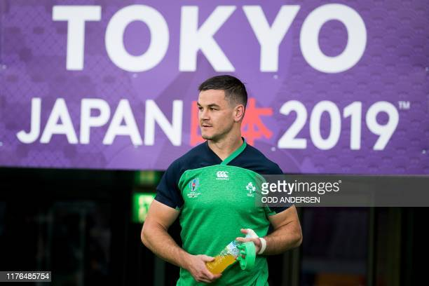 Ireland's fly-half Jonathan Sexton arrives for the captain's run training session at the Tokyo stadium on October 18 on the eve of their...