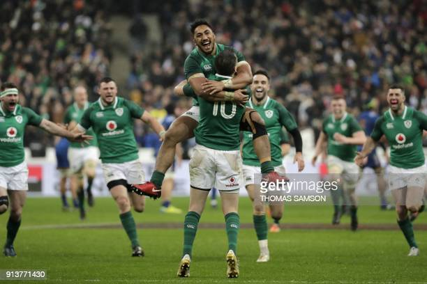 TOPSHOT Ireland's flyhalf Jonathan Sexton celebrates with Ireland's centre Bundee Aki after scoring a drop goal to win the Six Nations rugby union...