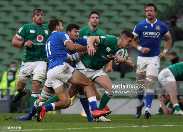Ireland's flyhalf Jonathan Sexton scores his team's fifth try during the Six Nations international rugby union match between Ireland and Italy at the...