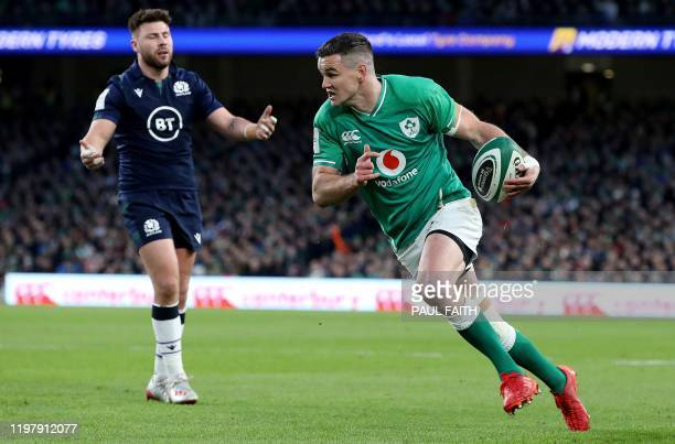 Ireland's flyhalf Jonathon Sexton runs to scores his team's first try during the Six Nations international rugby union match between Ireland and...