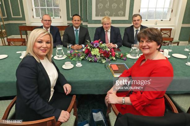 Ireland's Foreign Minister Simon Coveney, Ireland's Prime Minister Leo Varadkar, Britain's Prime Minister Boris Johnson and Britain's Northern...