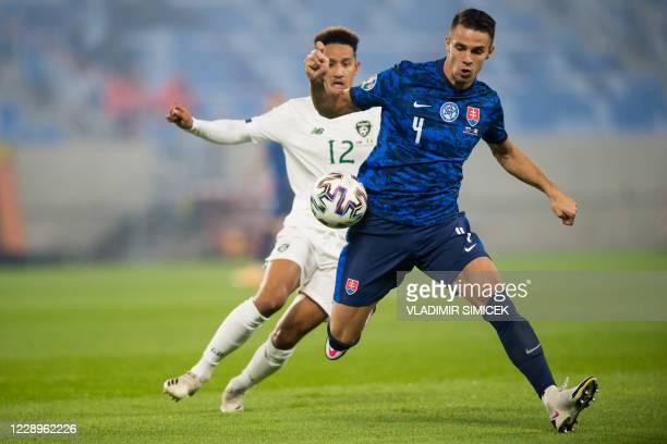 Ireland's forward Callum Robinson and Slovakia's defender Martin Valjent vie for the ball during the Euro 2020 play-off semi-final football match...