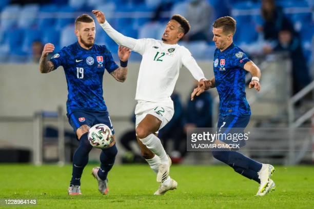 Ireland's forward Callum Robinson vies for the ball with Slovakia's midfielder Juraj Kucka ad Slovakia's defender Peter Pekarik during the Euro 2020...