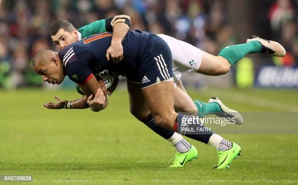 Ireland's full back Rob Kearney tackles France's center Gael Fickou during the Six Nations international rugby union match between Ireland and France...