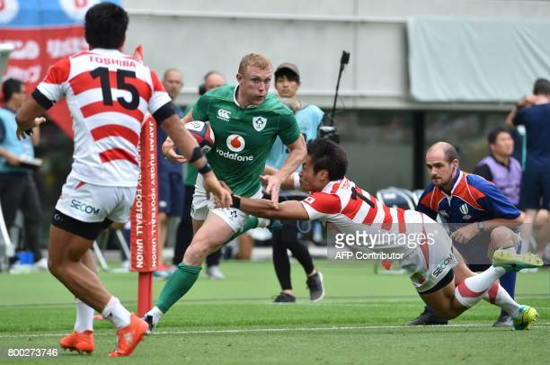 Ireland's fullback Andrew Conway runs away past Japan's leftwing Kenki Fukuoka during their rugby union Test match in Tokyo on June 24 2017 / AFP...