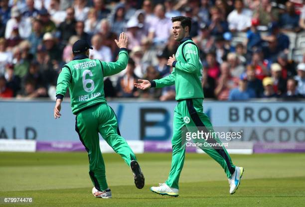 Ireland's George Dockrell celebrates with team mate William Porterfield after claiming the wicket of Sam Billings of England during the Royal London...