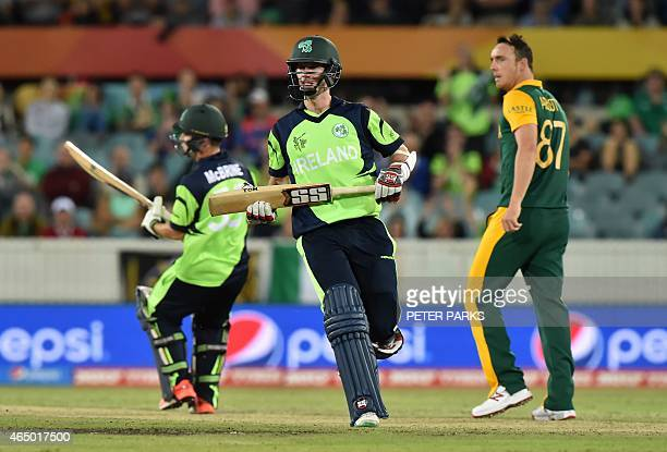 Ireland's George Dockrell runs between the wickets during the 2015 Cricket World Cup Pool B match between Ireland and South Africa in Canberra on...