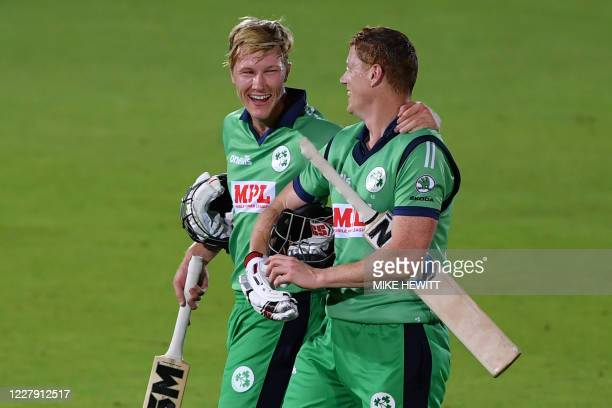 Ireland's Harry Tector and Ireland's Kevin O'Brien react as they leave after leading their side to victory in the third One Day International cricket...