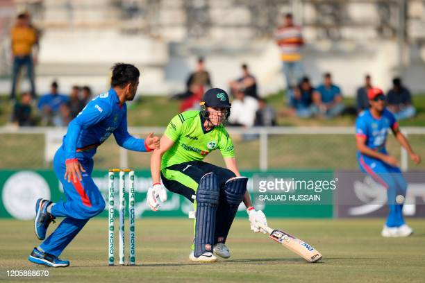 Ireland's Harry Tector makes to the crease during the second T20 cricket match between Afghanistan and Ireland in Greater Noida, Uttar Pradesh state...