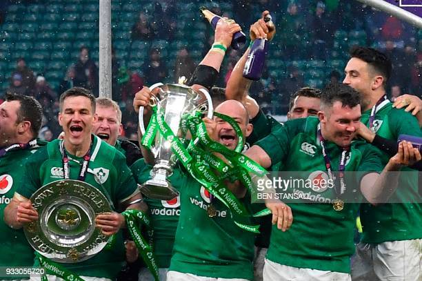 Ireland's hooker Rory Best holds the Six Nations trophy and Ireland's fly-half Jonathan Sexton the Triple Crown as they celebrate their Six Nations...