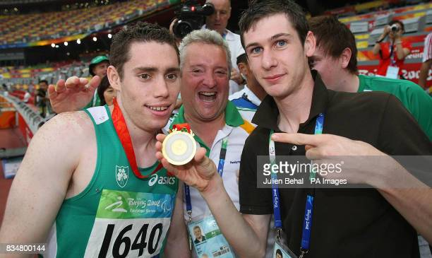 Ireland's Jason Smyth with fellow gold medalist Michael McKillop and coach Stephen Maguire after winning the gold medal in the men's 100M T13 Final...