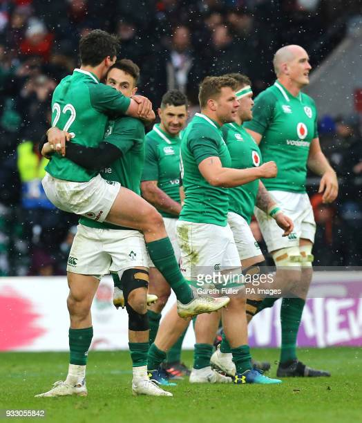 Ireland's Joey Carbery celebrates winning the grand slam with team mates during the NatWest 6 Nations match at Twickenham Stadium London