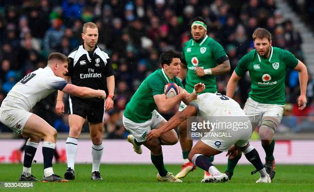Ireland's Joey Carbery is tackled during the Six Nations international rugby union match between England and Ireland at the Twickenham west London on...