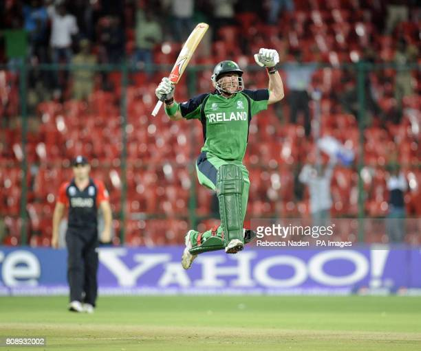 Ireland's John Mooney celebrates scoring the winning runs during the ICC Cricket World Cup match at the at M Chinnaswamy Stadium Bangalore India