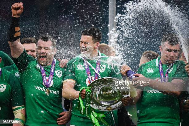 Ireland's Johnny Sexton Peter O'Mahony and Cian Healy celebrate with the Triple Crown trophy after the NatWest Six Nations Championship match between...