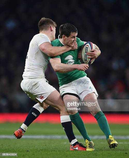 Ireland's Jonathan Sexton is tackled by Owen Farrell of England during the 2016 RBS Six Nations Championship match between England and Ireland at...