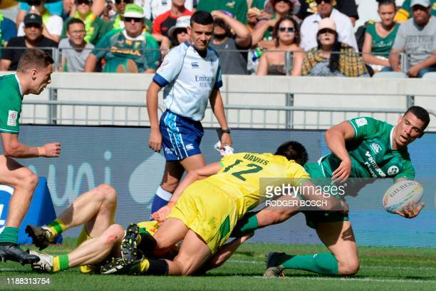 Ireland's Jordan Conroy is tackled by Australia's Rodney Davies during the HSBC World Rugby Sevens Series men's rugby match between Australia and...