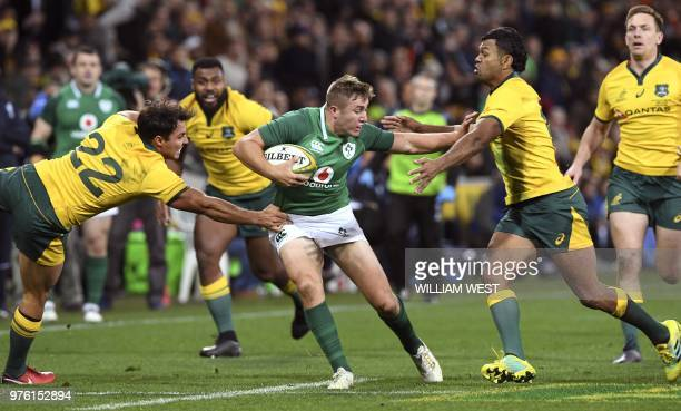 Ireland's Jordan Larmour is tackled by Australian Wallabies Nick Phipps and Kurtley Beale during the second rugby union Test match between Ireland...