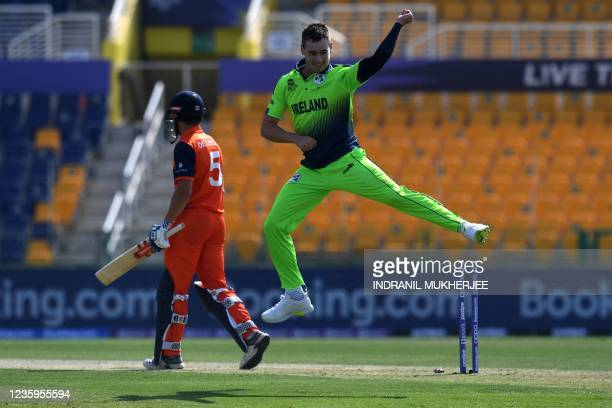 Ireland's Josh Little celebrates after taking the wicket of Netherland's Bas de Leede during the ICC mens Twenty20 World Cup cricket match between...