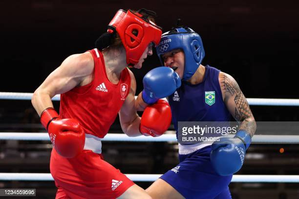Ireland's Kellie Anne Harrington and Brazil's Beatriz Ferreira fight during their women's light boxing final bout during the Tokyo 2020 Olympic Games...