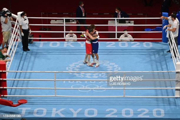 Ireland's Kellie Anne Harrington and Brazil's Beatriz Ferreira hug after their women's light boxing final bout during the Tokyo 2020 Olympic Games at...