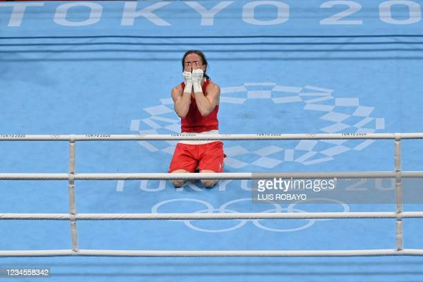 Ireland's Kellie Anne Harrington celebrates after winning against Brazil's Beatriz Ferreira after their women's light boxing final bout during the...