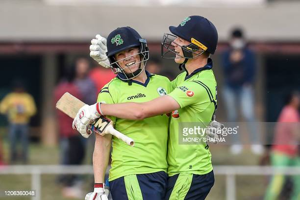 Ireland's Kevin O'Brien and teammate Harry Tector celebrate after winning the third T20 between Afghanistan and Ireland in Greater Noida on March 10...
