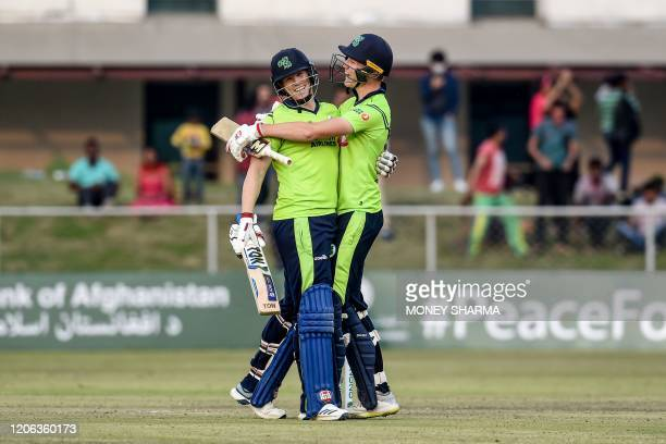 Ireland's Kevin O'Brien and teammate Harry Tector celebrate after winning the third T20 between Afghanistan and Ireland in Greater Noida on March 10,...