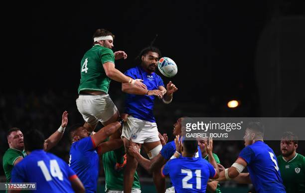 TOPSHOT Ireland's lock Iain Henderson and Samoa's flanker Chris Vui jump for the ball in a line out during the Japan 2019 Rugby World Cup Pool A...