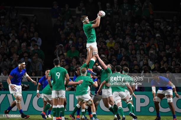 Ireland's lock Iain Henderson catches the ball in a lineout during the Japan 2019 Rugby World Cup Pool A match between Ireland and Samoa at the...