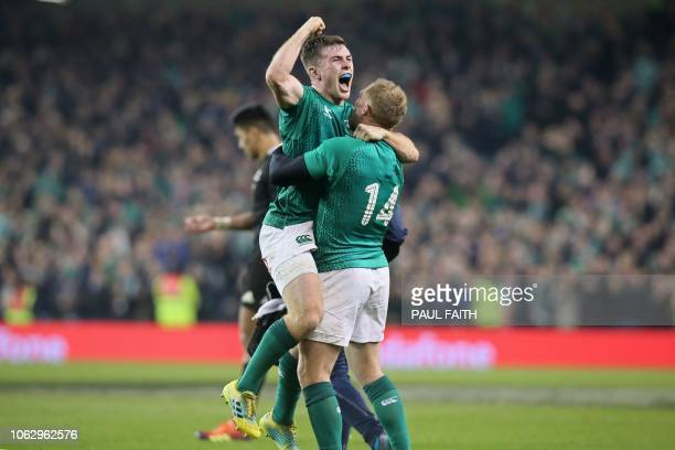 Ireland's Luke McGrath celebrates with Ireland's wing Keith Earls on the final whistle in the rugby union test match between Ireland and New Zealand...