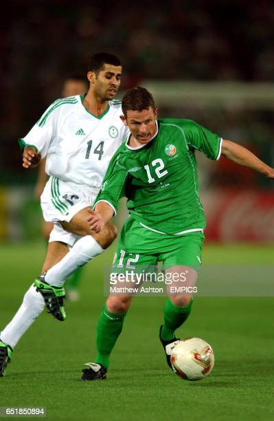 Ireland's Mark Kinsella evades the challenge of Saudi Arabia's Abdulaziz Khathran