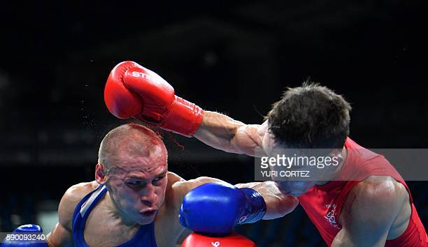Ireland's Michael John Conlan fights Russia's Vladimir Nikitin during the Men's Bantam Quarterfinal 1 match at the Rio 2016 Olympic Games at the...