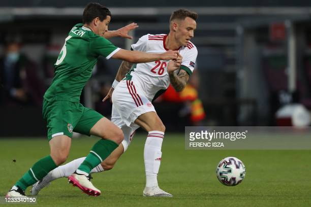 Ireland's midfielder Josh Cullen and Hungary's midfielder Bendeguz Bolla vie for the ball during the friendly football match between Hungary and the...