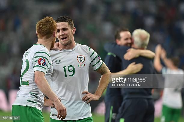 Ireland's midfielder Robert Brady and Ireland's midfielder Stephen Quinn celebrate after the Euro 2016 group E football match between Italy and...