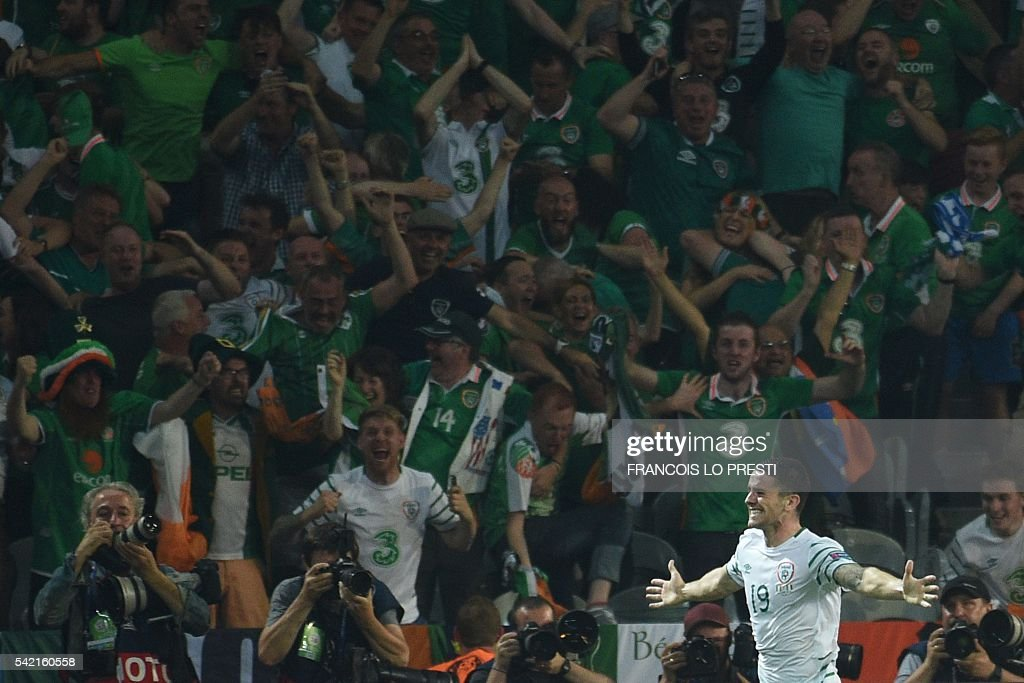 Ireland's midfielder Robert Brady celebrates after scoring during the Euro 2016 group E football match between Italy and Ireland at the Pierre-Mauroy stadium in Villeneuve-d'Ascq, near Lille, on June 22, 2016. / AFP / FRANCOIS