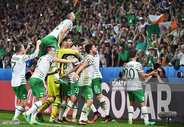 Ireland's midfielder Robert Brady celebrates scoring a goal with team mates during the Euro 2016 group E football match between Italy and Ireland at...