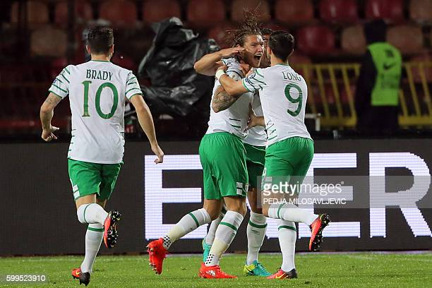Ireland's midfielders Robbie Brady Jeff Hendrick and forward Shane Long celebrate goal during the World Cup 2018 qualifier football match Serbia vs...