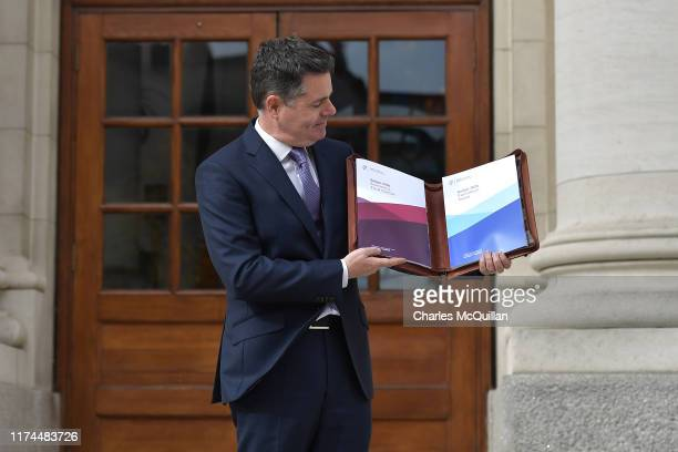 Ireland's Minister for Finance Paschal Donohoe unveils its 2020 Budget at Government Buildings on October 8 2019 in Dublin Ireland The minister has...