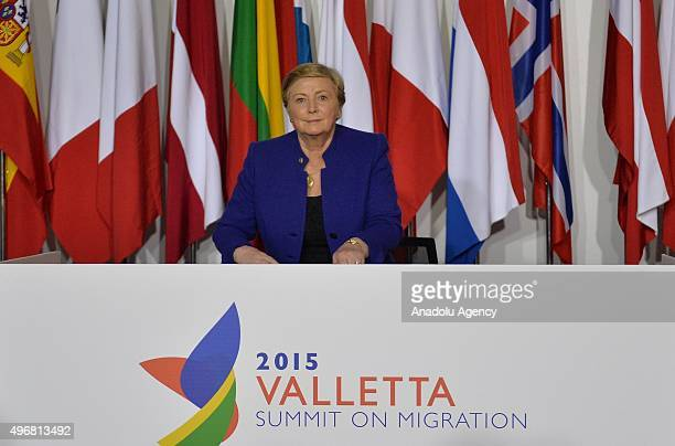Ireland's Minister for Justice and Equality Frances Fitzgerald signs for the 'trust fund' during the second day of the '2015 Valletta Summit on...