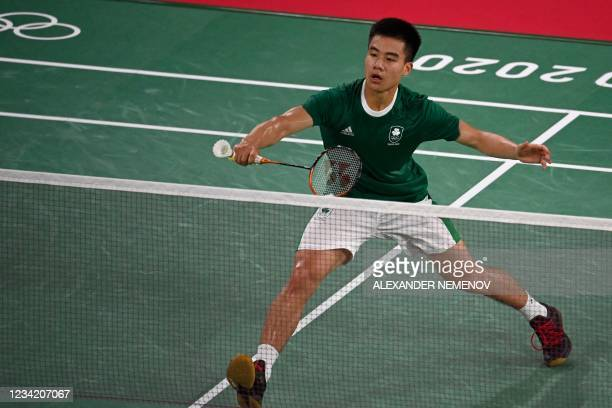 Ireland's Nhat Nguyen hits a shot to Sri Lanka's Niluka Karunaratne in their men's singles badminton group stage match during the Tokyo 2020 Olympic...