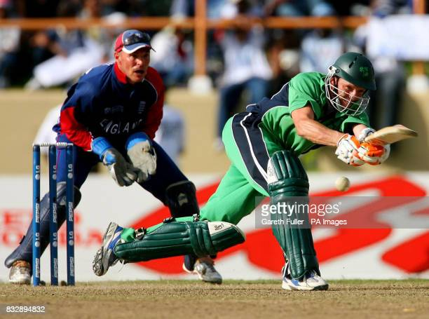 Ireland's Niall O'Brien in action watched by England wicketkeeper Paul Nixon during the ICC Cricket World Cup Super Eights match at the Guyana...