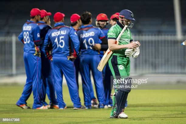 Ireland's Niall O'Brien walks off the field after being dismissed during the third one day international cricket match between Afghanistan and...