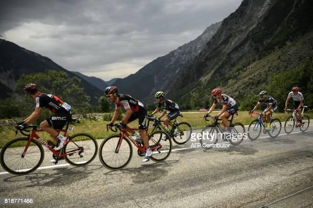 Ireland's Nicolas Roche Switzerland's Danilo Wyss Colombia's Esteban Chaves Great Britain's Ben Swift and Netherlands' Marco Minnaard ride in a...