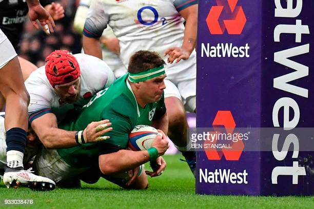 Ireland's number 8 Cj Stander grounds the ball at the base of the post to score their second try during the Six Nations international rugby union...