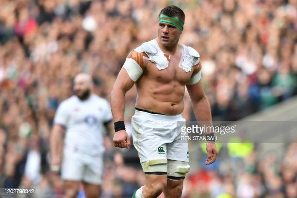 Ireland's number 8 Cj Stander loses his shirt in a clash with England's lock Maro Itoje during the Six Nations international rugby union match...