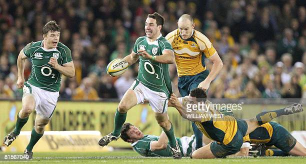 Ireland's Paddy Wallace supported by teammate Brian O'Driscoll is tackled by Australians George Smith and Stirling Mortlock in their Test match...