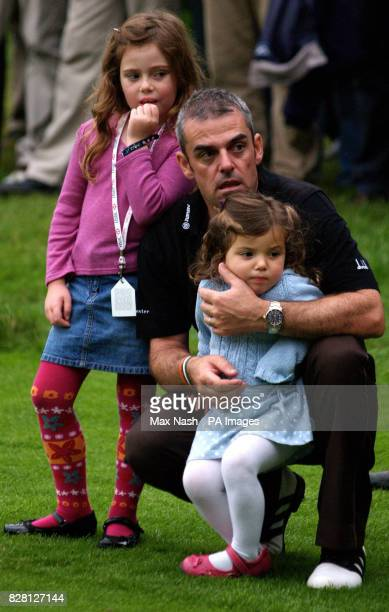 Ireland's Paul McGinley with his daughters Nainh and Maia watch New Zealand's Michael Campbell receive the HSBC World Match Play Championship trophy...
