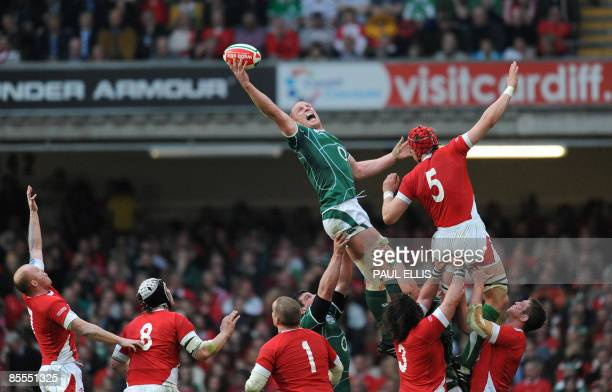 Ireland's Paul O'Connell reaches the ball in the lineout with Wales' Alun Wyn Jones during the Six Nations title deciding rugby match between Wales...